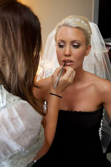 Bride getting her makeup done