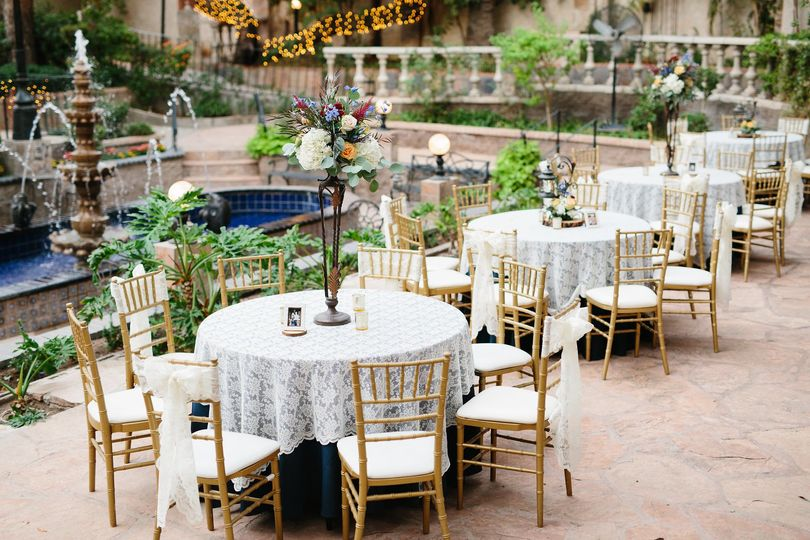 Reception tables and gold chiavari chairs