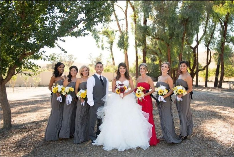 The couple with their bridesmaid