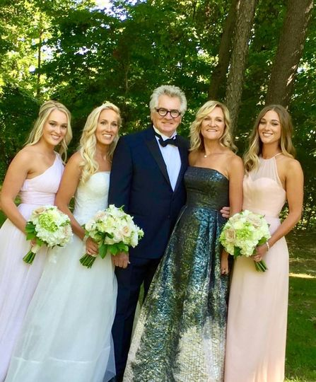 Groom and bride with the bridesmaids