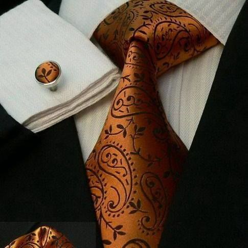 Orange tie, handkerchief, and pin