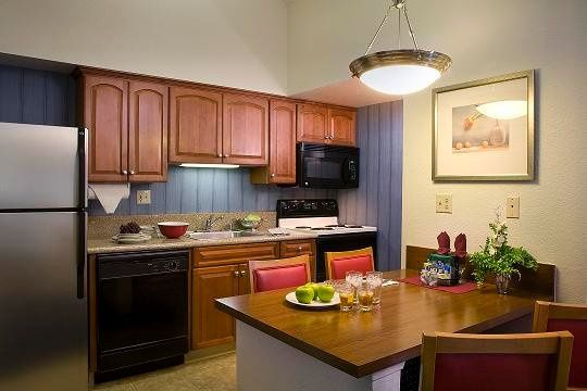 All suites have fully equipped kitchens with full size appliances, refrigerator and stove/oven....