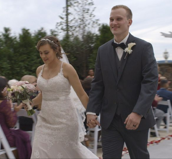 Young couple rushing down the aisle
