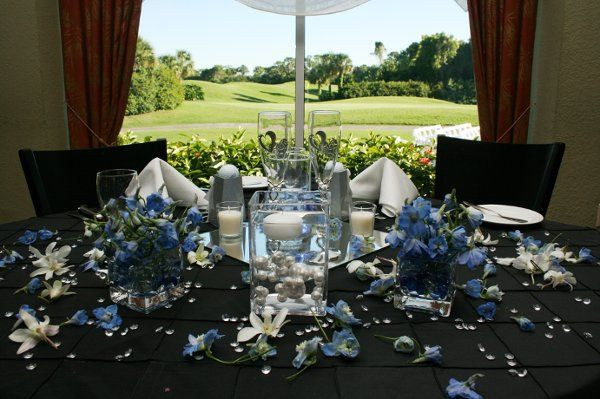 Black table setup with blue flowers