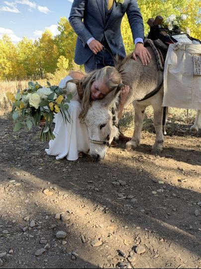 Getting a hug from the bride