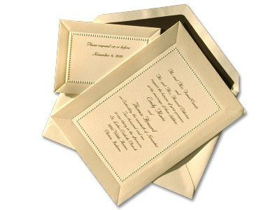 This wedding invitation ensemble is a classic choice. The elegant invitation in ecru encloses your...