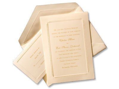 Ageless in style, this wedding invitation ensemble is printed on soft white stationery with a panel...