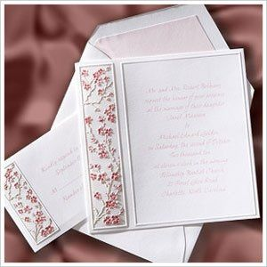 This square elegant invitation features deeply embossed cherry blossoms with soft petal and claret...