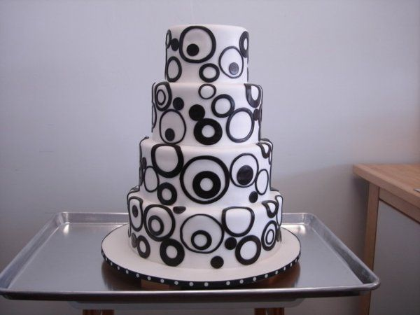 This cake was commissioned for a bride who sought something more modern and deco. She brought in a...