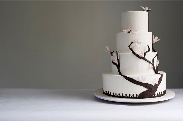 "A popular design is our ""Lily Cake"" which has a decor of a tree climbing up the side of the cake,..."