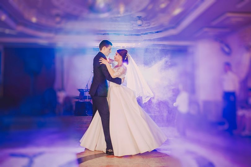 Couple's first dance indoors