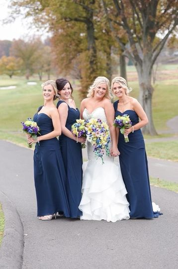 Smiling bride and bridesmaids