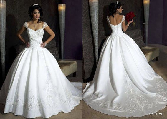 This devine bridal gown features cap sleeves, ballgown skirt with delicate detailing, and an...