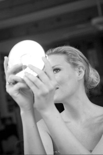 Bride looking in a mirror
