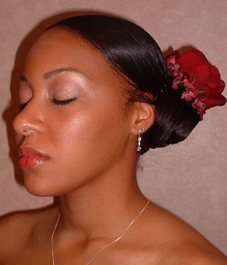 Neat pulled back hair with flower accessory