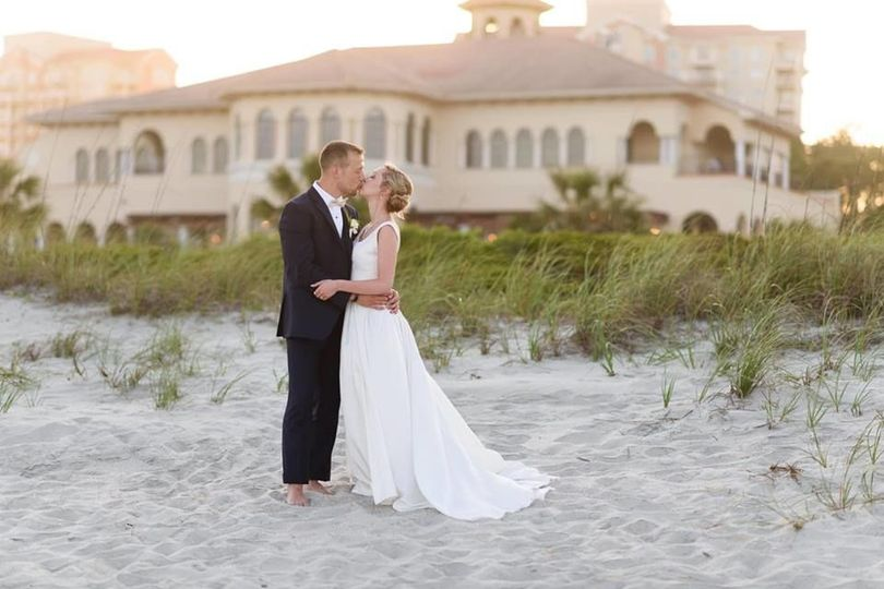 Intimate beach pictures at sunset with your wedding venue in the background - perfection!