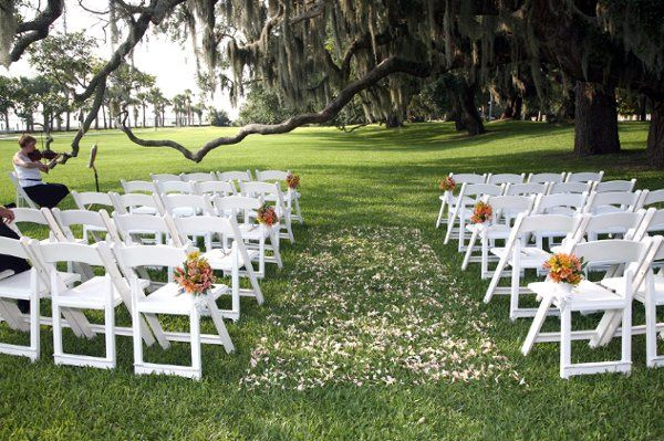 Ceremony under the oaks on the riverfront lawn