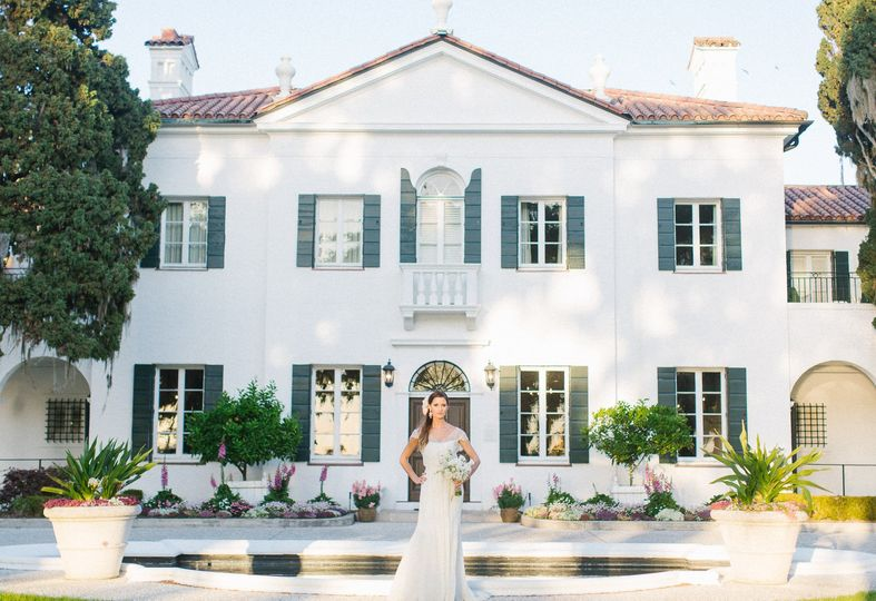 Bride in front of crane cottage