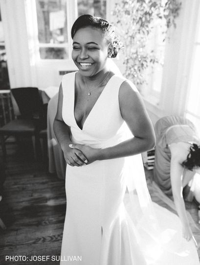 Smiling bride in gown
