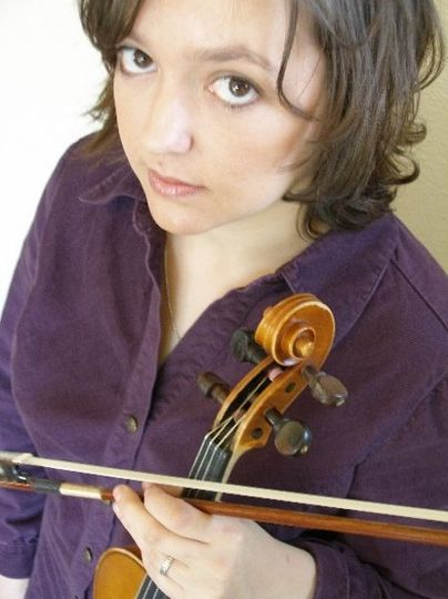 Paula can serenade you guests with sweet love songs, or sizzle with violin brilliance in any style....