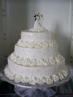 White wedding cake with figurine on top