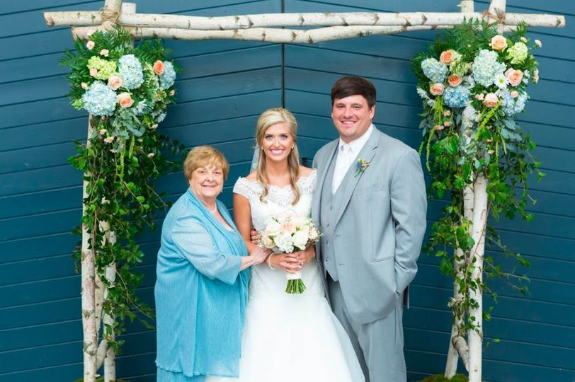 The newlyweds with the mother of the bride