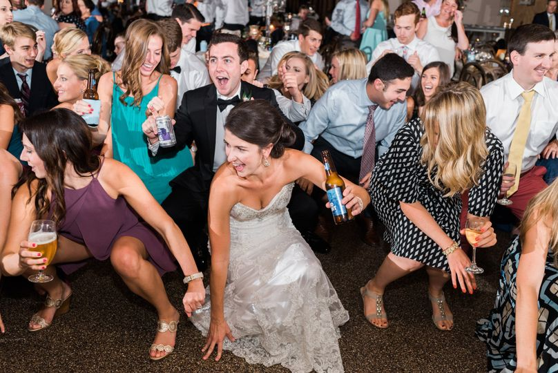 Dancing newlyweds and guests