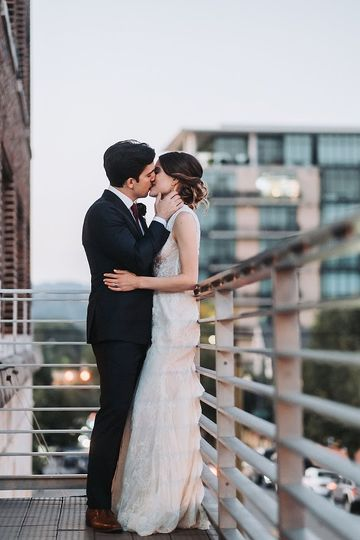 Sharing a kiss on our balcony