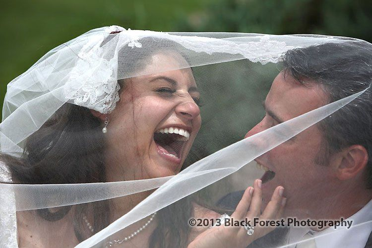 Candid laughing photograph of the bride and groom