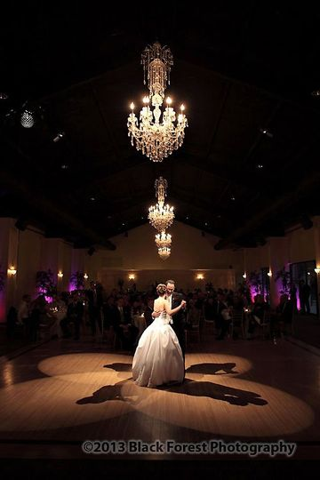 Natural light first dance of the bride and groom in the ballroom of The Pinery in Black Forest,...
