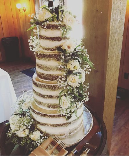 This naked cake was one of my favorites to help set up! It was so romantic and went perfect with the...