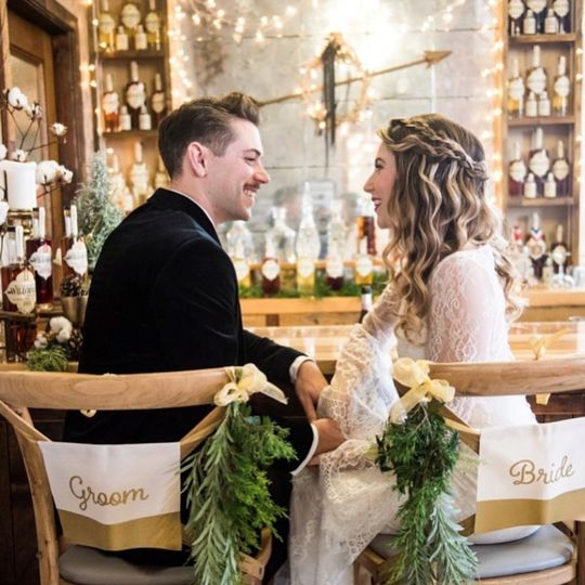 Bride and groom in bar area