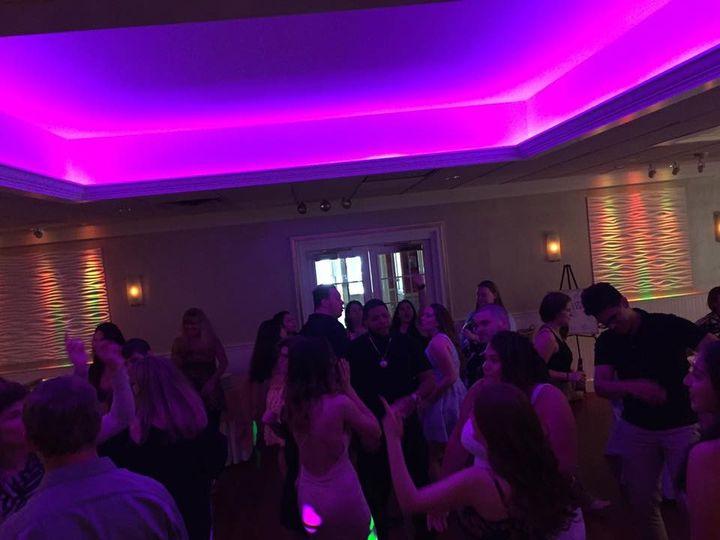 Guests dancing in violet lights