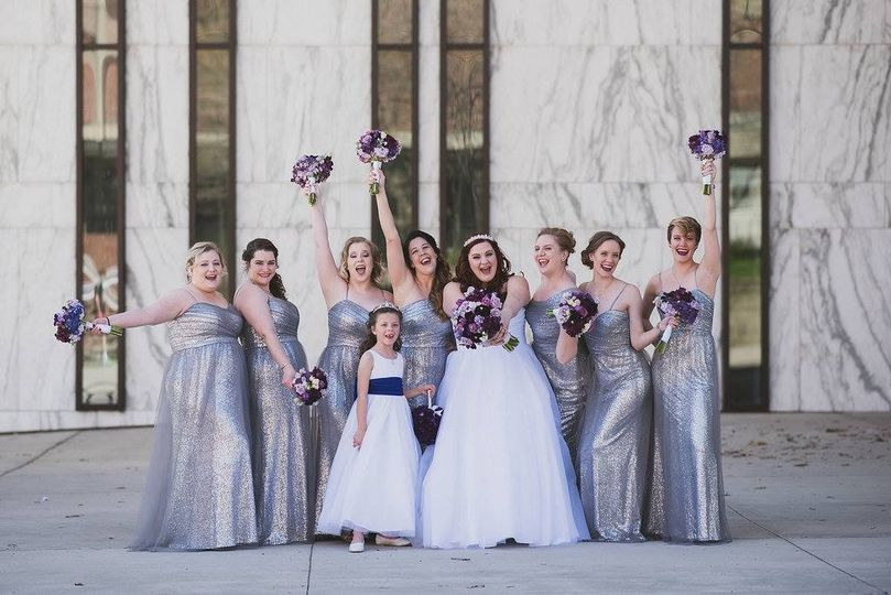 The bride with her bridesmaids and the flower girl