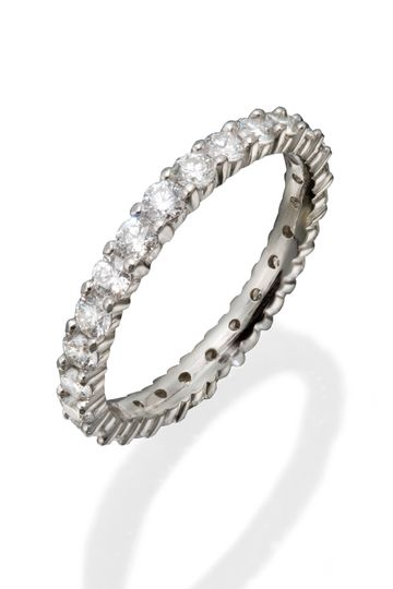 A lady's classic eternity band with round diamonds in shared prong settings.
