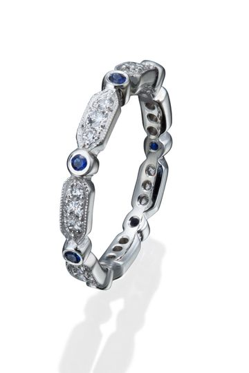 Classic sapphire and diamond wedding band with a vintage twist.