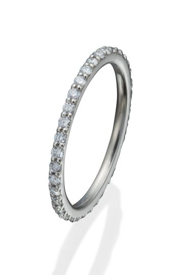 A lady's ultra thin classic eternity band with round diamonds in shared prong settings.