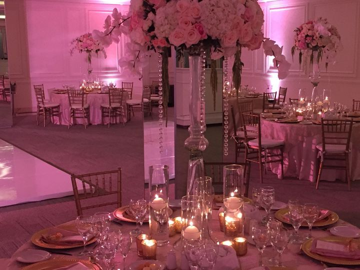 Pink uplighting and candlelit tables