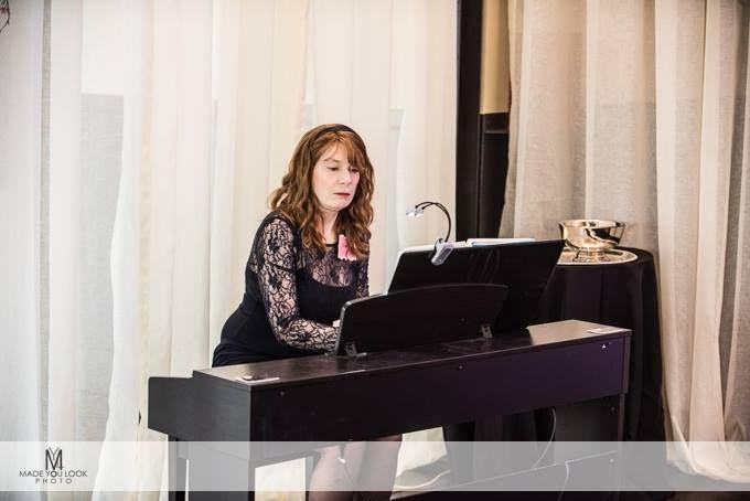 d24b1ebcbd413ef7 Jenny playing piano at WIPA meetin