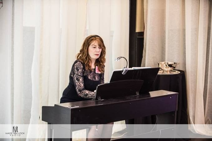 jenny playing piano at wipa meetin