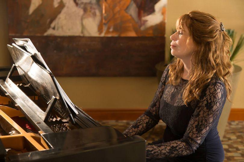 jenny playing piano at westin buckhead