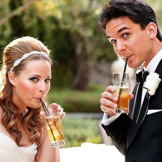 Newlyweds sipping cocktails