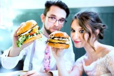 Newlyweds eating burgers