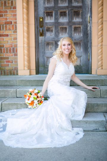 Bride sitting on the front steps