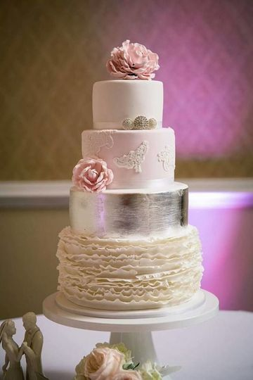 4-tier floral wedding cake with metallic layer