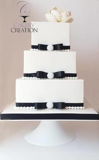 Three-tier square cut wedding cake
