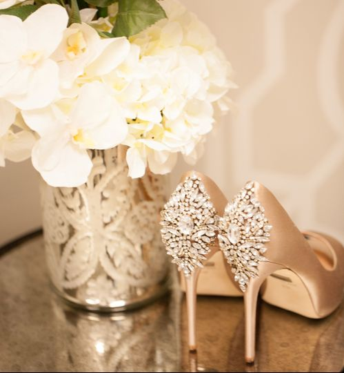 Shoes by the floral centerpiece