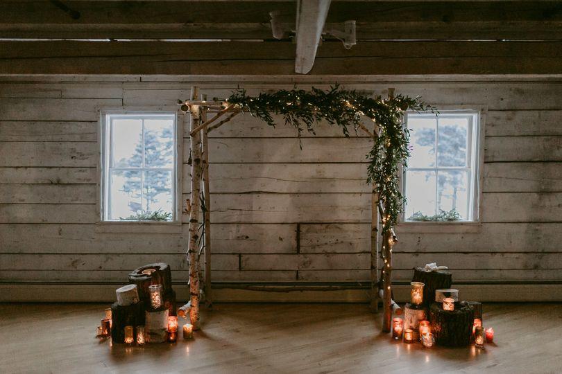 Candlelit wedding arch