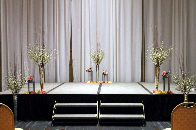 Stage for ceremony area.  Brushed Silver Lanterns and Mercury Glass Haversham Vases.  Moved to Head...