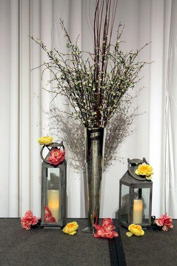 Brushed silver lanterns with mercury glass haversham vases